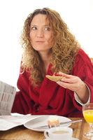 Cute Girl is eating breakfast