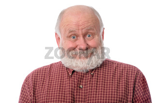Senior man shows surprised smile facial expression, isolated on white