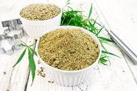 Flour hemp and grain in bowls on light board