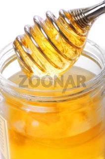 Honig im Glas mit Portionierer