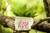 "Stinging Nettle in a jute bag with the word ""Superfood"""