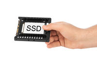 Hand and computer SSD drive