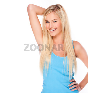 Happy young blonde woman in her late teens smiling. Isolated on a white background
