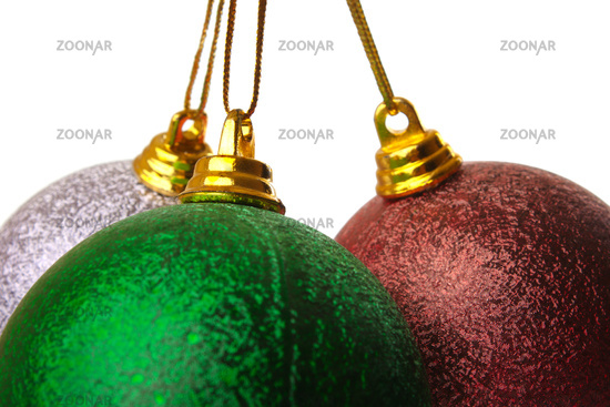 part of three colored Christmas balls hanging on white background it's isolated