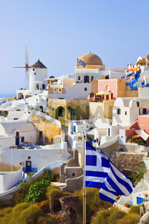 Santorini view (Oia) and greek flag