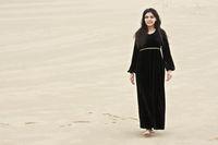 Positive brunette in sands