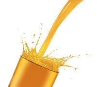 pouring splashing orange juice in glass