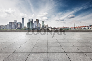 empty floor with cityscape and skyline of chongqing in clous sky