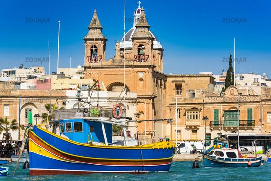 Coloful boats in Marsaxlokk port in Malta