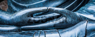 Detail of Buddha statue with Dhyana hand position, the gesture of meditation