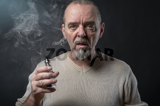 portrait of a man with beard who is vaping