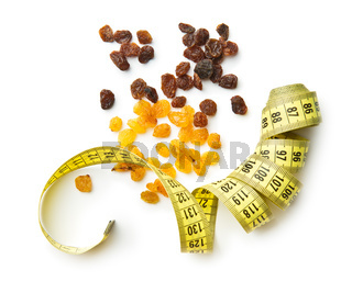 Sweet dried raisins and measuring tape.