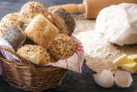 Basket with mixed buns and ingredients