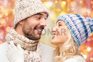 close up of couple in winter clothes hugging