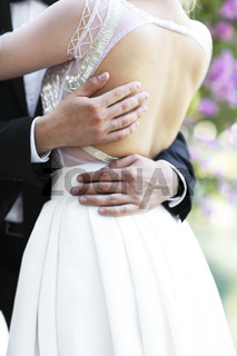 Young bride and groom outdoors