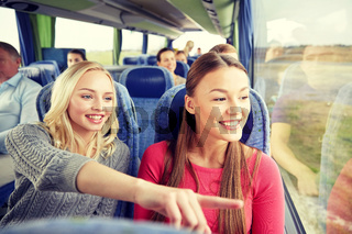 happy young women riding in travel bus