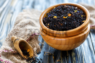 Black tea with bergamot in a wooden bowls.