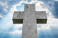 gravestone, stone cross isolated on sky background
