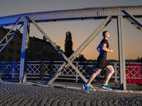 man jogging across the bridge in the city