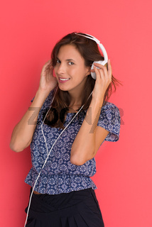 woman with headphones isolated on a red