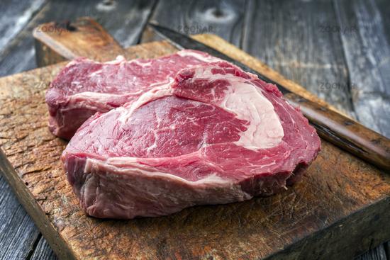 Dry Aged Rib-Eye Steak on old Cutting Board