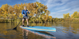 stand up paddling in fall colors