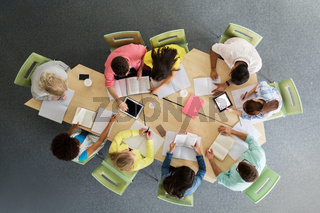 group of students with tablet pc at school library