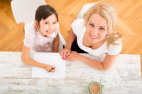 Mother helping her daughter with the homework