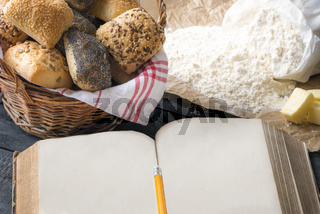 Blank open book and bread buns