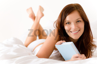 Bedroom - young woman with book