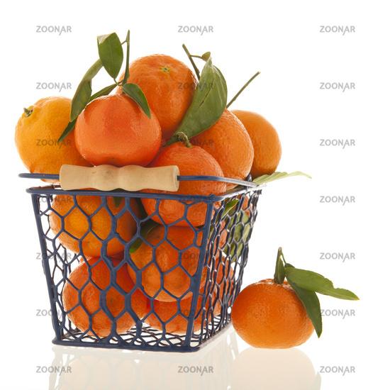 Tangerines iin basket solated over white background
