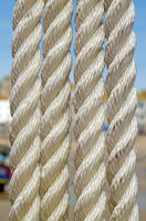 Four fishing boat ropes close up.