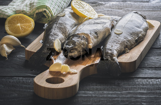 Uncooked fish on a cutting board