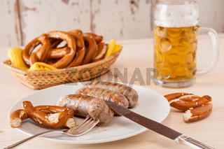 Bavarian cooked sausage and pretzel