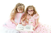 Twin princesses reading a book