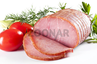 Rolled Fillet of Ham with Tomato and herbs as closeup in white background
