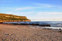 Sandy beach at sunset.