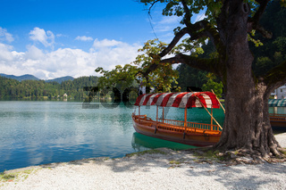 Boats at the pier of the Bled Island, Slovenia.