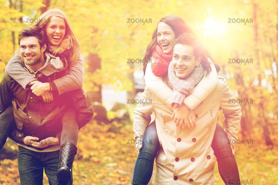 smiling friends having fun in autumn park