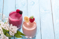 Two glasses of fresh healthy fruit smoothies