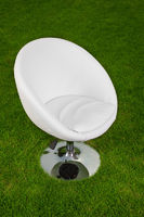 white design leather swivel chair on green grass