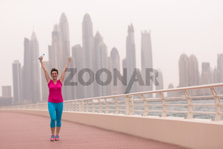 young woman celebrating a successful training run