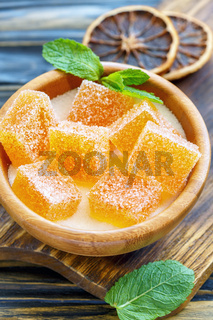 Homemade orange marmalade in a wooden bowl.