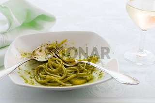 Closeup of eaten linguine pasta with pesto genovese and potatoes