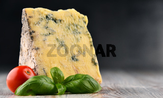 Piece of blue cheese isolated on the table.