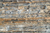 Old natural brown cabin wood wall. Wooden textured background pattern.