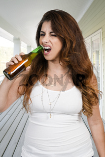 Woman opening a beer
