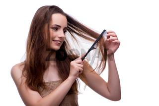 Woman in beauty concept combing hair