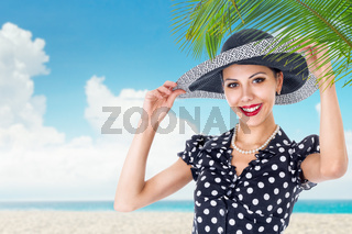 Young woman portrait in sun hat on the tropical beach