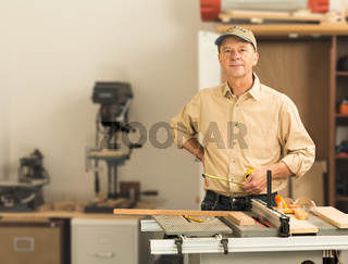 Senior caucasian man in home workshop